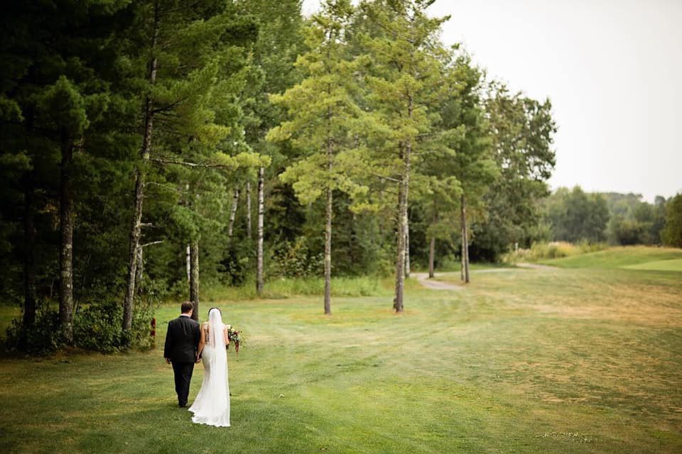 wedding couple walking fairway.jpg