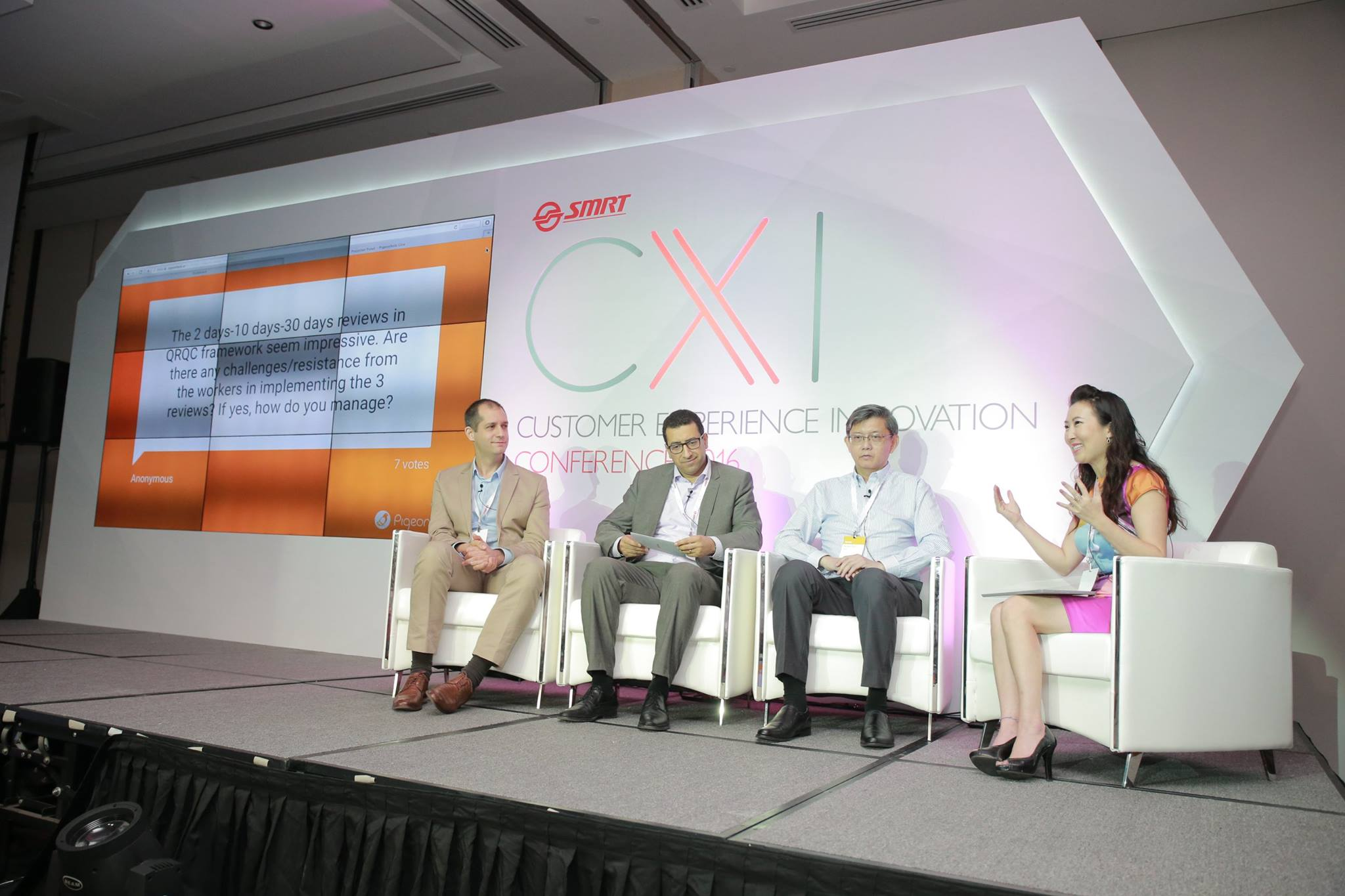 So-Young moderating a panel discussion with other experts and thought leaders