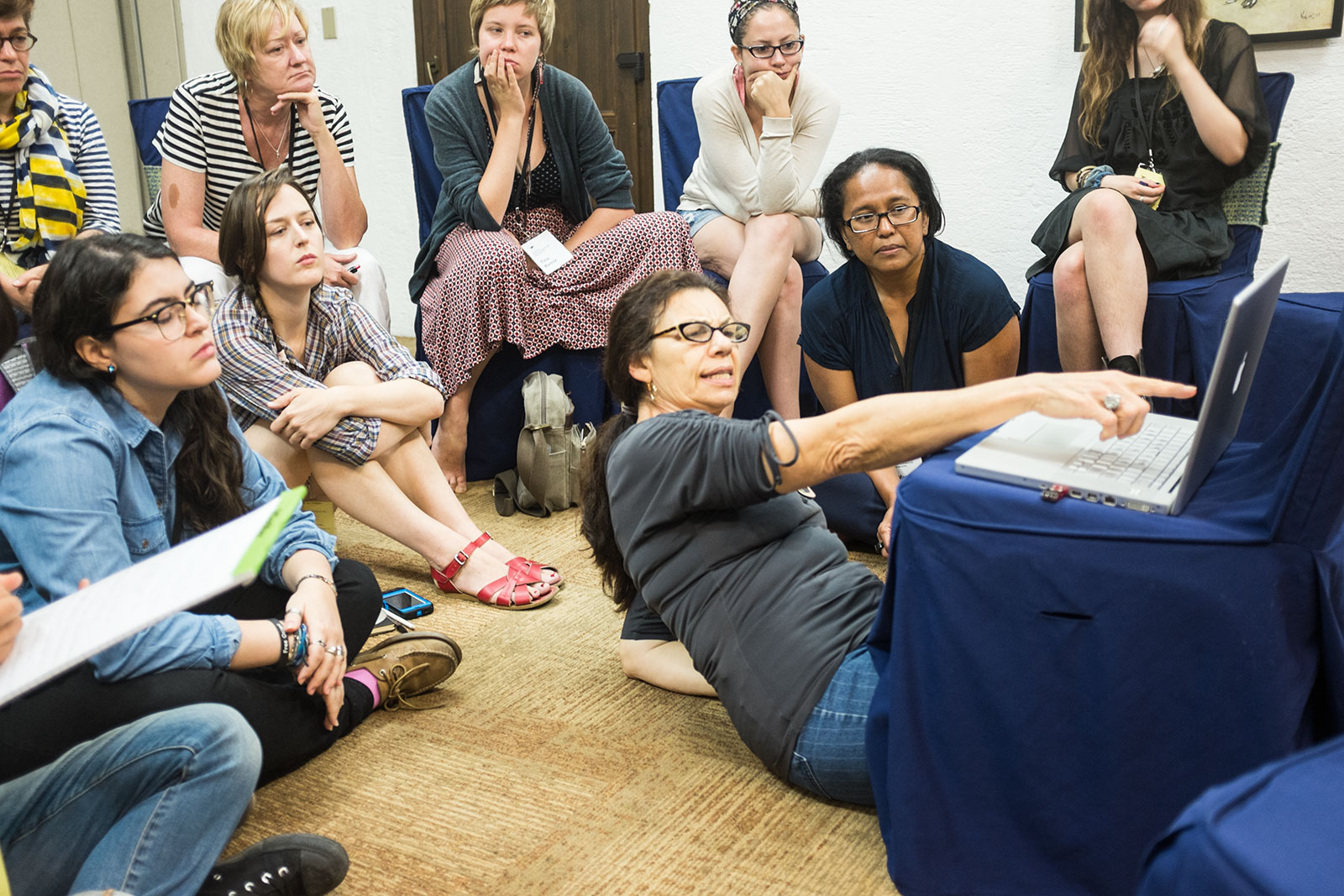 Foundry instructor Maggie Steber reviewing portfolios with her students on first day of workshop, July 21, 2014.jpg