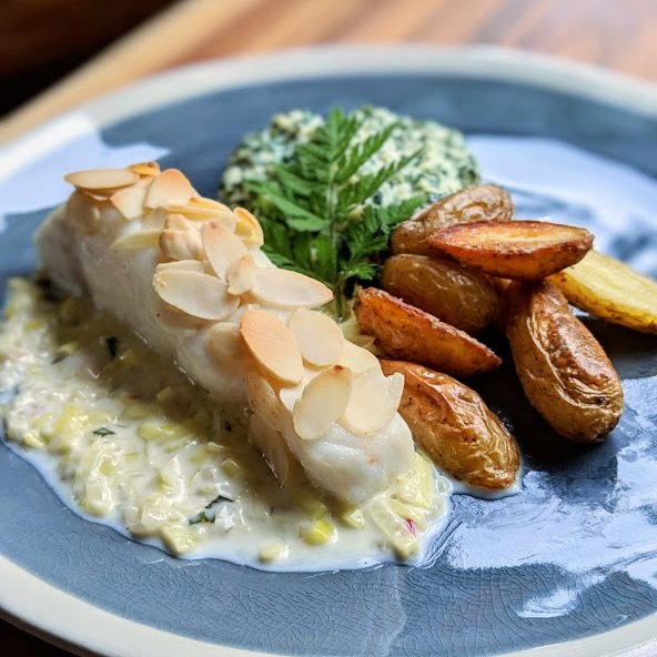 Almond-Crusted-Halibut-with-Tarragon-Leek-Cream-Sauce-Spinach-Souffle-and-Crispy-Fingerling-Potatoes.jpg