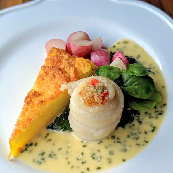 Crab-Stuffed-Sole-Roulade-with-Chive-Beurre-Blanc-Wilted-Garlicky-Greens-Seared-Radish-and-Potato-Soufflé-.jpg