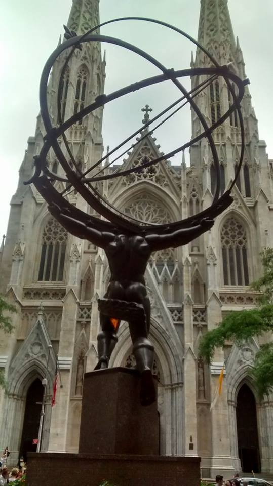 thanks for reading this far. photo of St Patrick's Cathedral in NY.   I think that is Atlas carrying a gyroscope. He seems to be late for Mass.