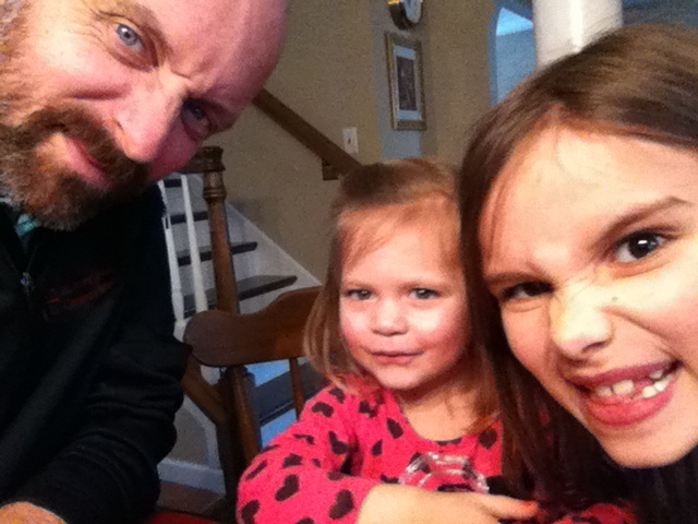 "with nieces at a family birthday. ""Cheese!"" good photo, mom!"