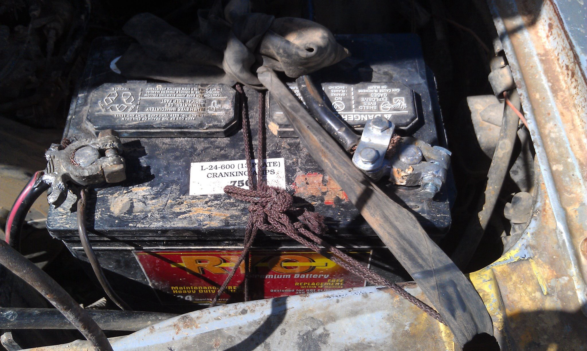 this is the car battery from the story. I am not making this up. note the shoelace [brown] and bike tire [black rubber] used to hold the battery in place