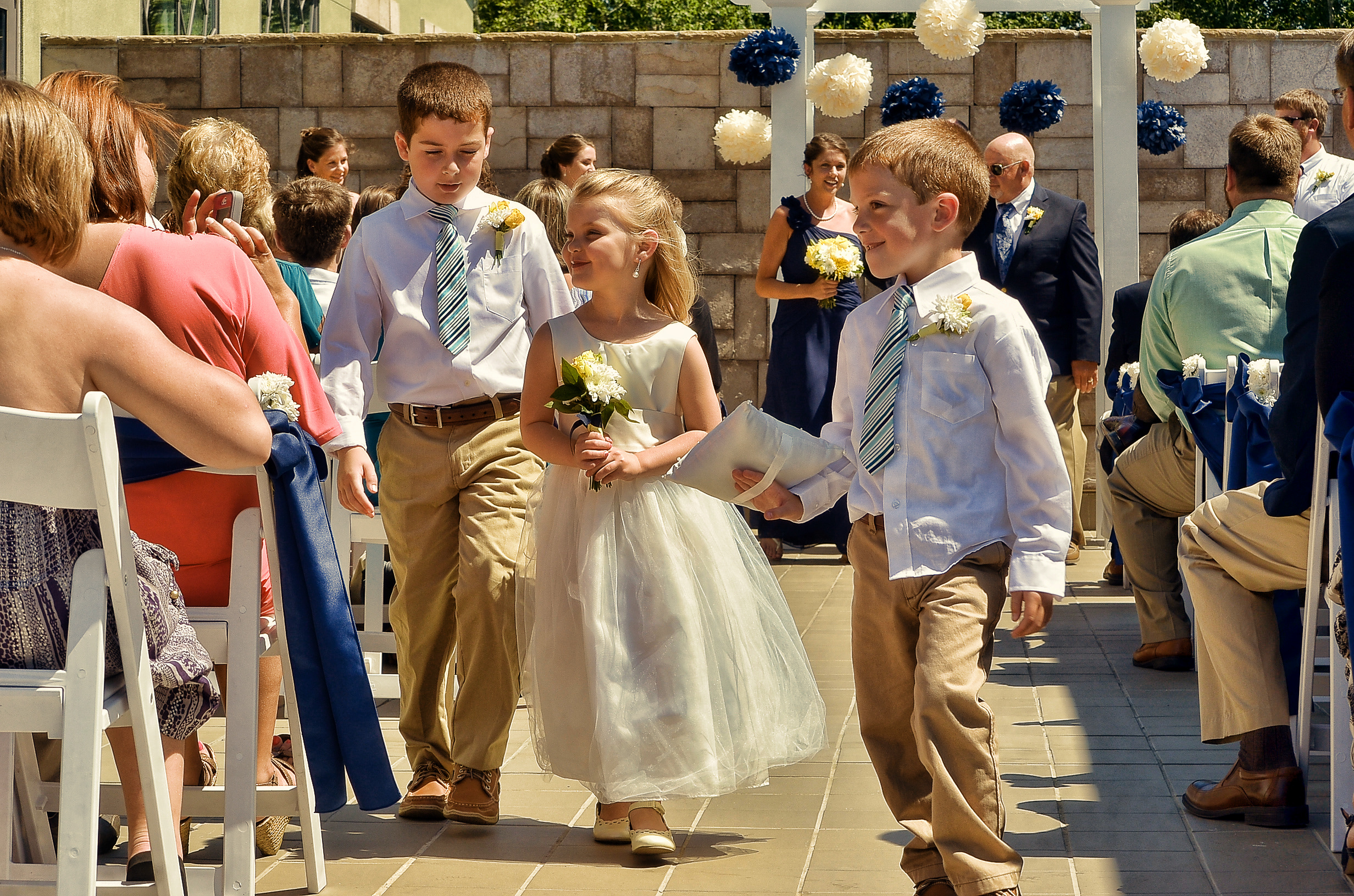 Flower Girl, walking up the aisle with ring bearers. Terraces on Sir Tyler.