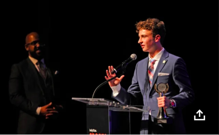 Gabe Imes accepting the award for Play of the Year (photo taken by IndyStar)