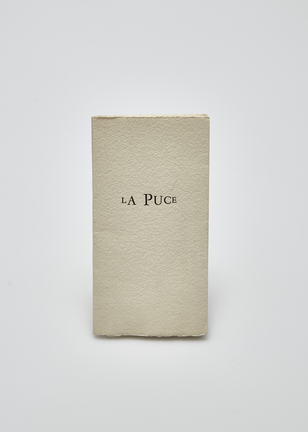 La Puce    Text by Fernando Arrabal and engarving by Julius Baltazar  1984 | 16 x 8 cm | eau forte and typography | 99 prints