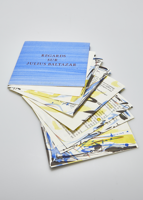 Regards sur Julius Baltazar    Texte F. Arrabal, P. Bélanger, M. Butor, G. E. Clancier, G. Cloutier, J. Cortot, Ph. Delaveau, H. Dorion, L. Albertini-Guillevic, E. Guillevic et gravure Julius Baltazar    2000 | 16 x 16 cm | gravure rehaussée et typographie | 125 exemplaires | édition Coquecigrues