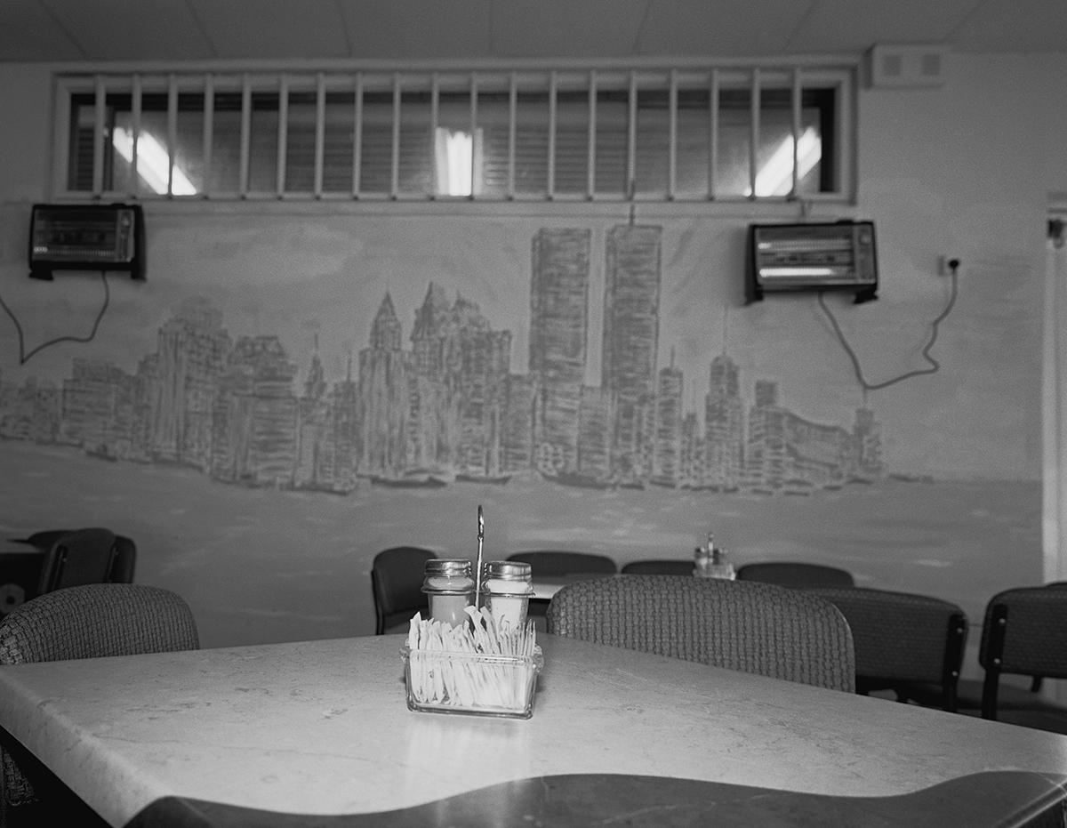 "August 12, 2001, ""Wall Street"" cafe, Kiryat Motzkin. Photographed: February 2003"