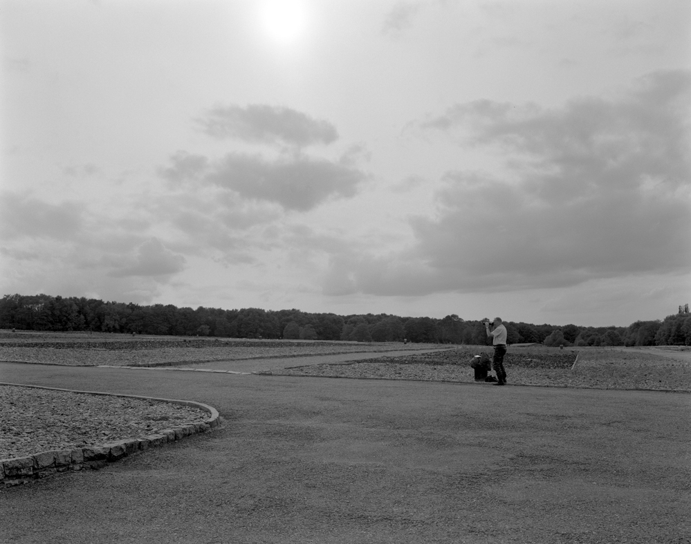 A Tourist photographing the absence of prisoners' barricades, Buchenwald 2007