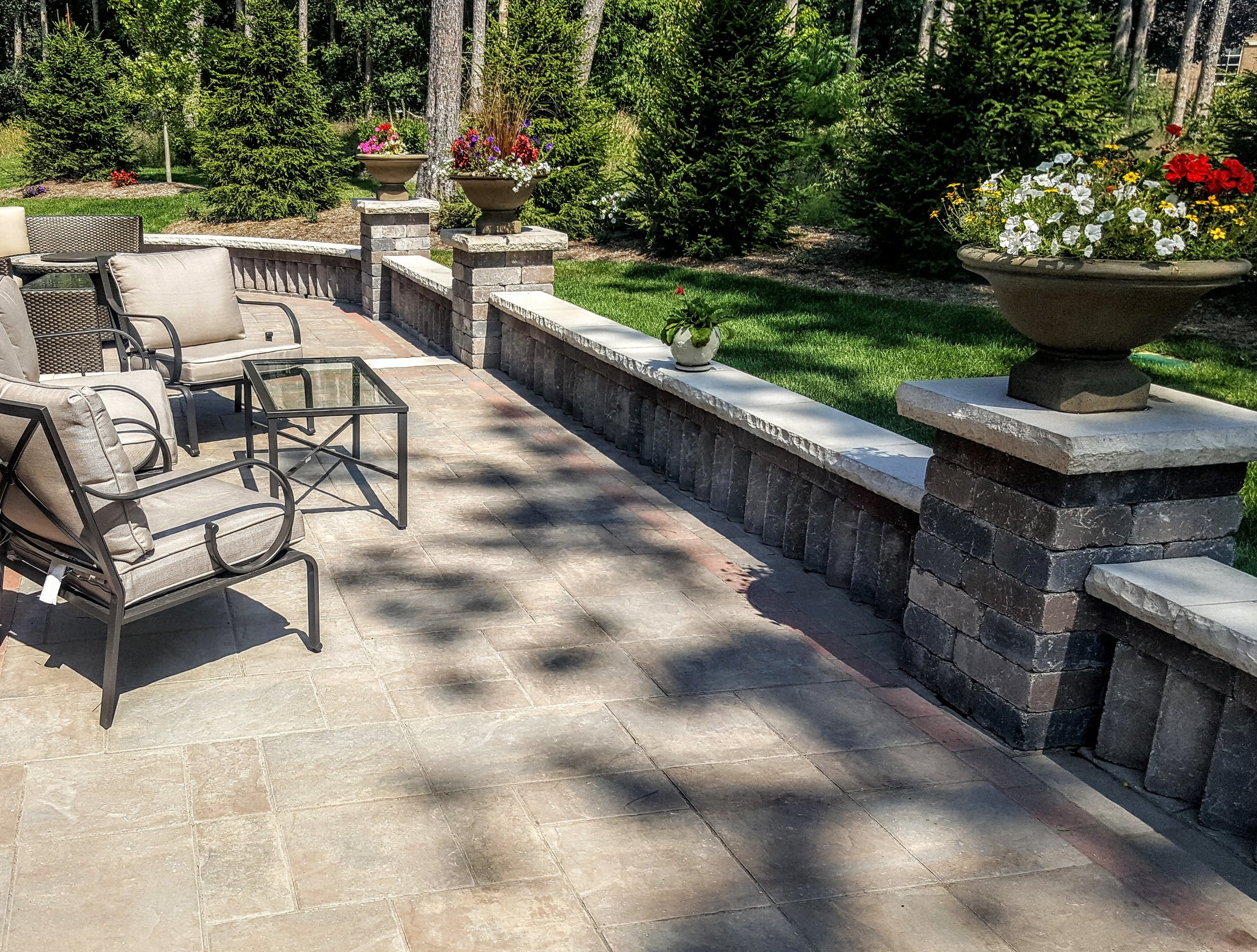 Custom Designs - Your experience with Cene's Landscape Services Inc. begins with a consultation, where we will learn about your expectations for your landscaping. Then we will create a custom design for your home or business that fits your needs and your budget. Once you approve the design we will use the finest materials from Unilock, Oaks, Fendt and natural stones to create beautiful walkways, driveways, patios, retaining walls and flower boxes. With the proper choice of shrubbery, trees and flowers we will create a landscape that will have an immediate impact and grow to be even better in the years to come.Visit our photo gallery for examples of some of our previous work.