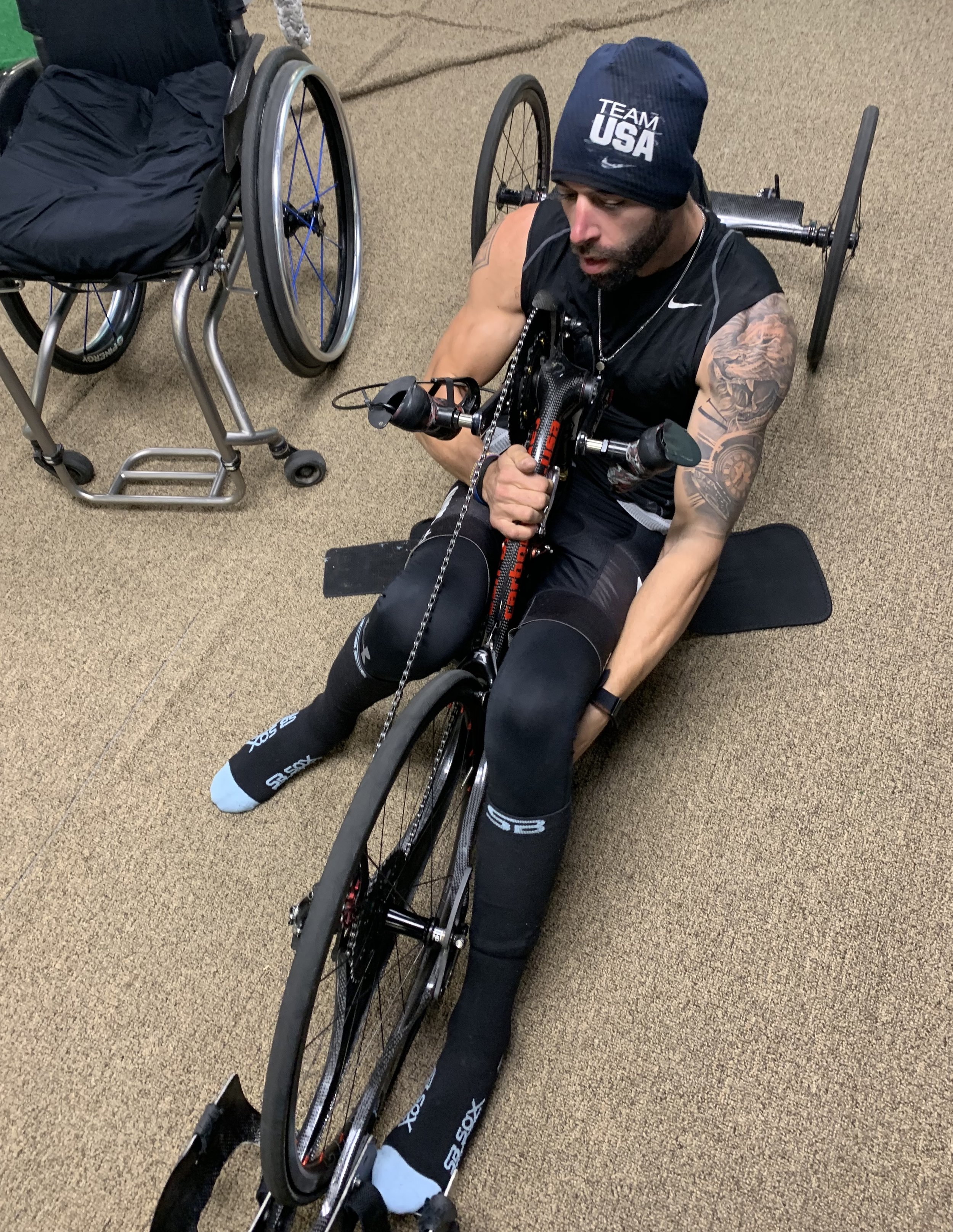 Brandon Lyons • US Paralympic Cycling Team • 2019 World Champion qualifier • getting into his custom-fitted hand cycle
