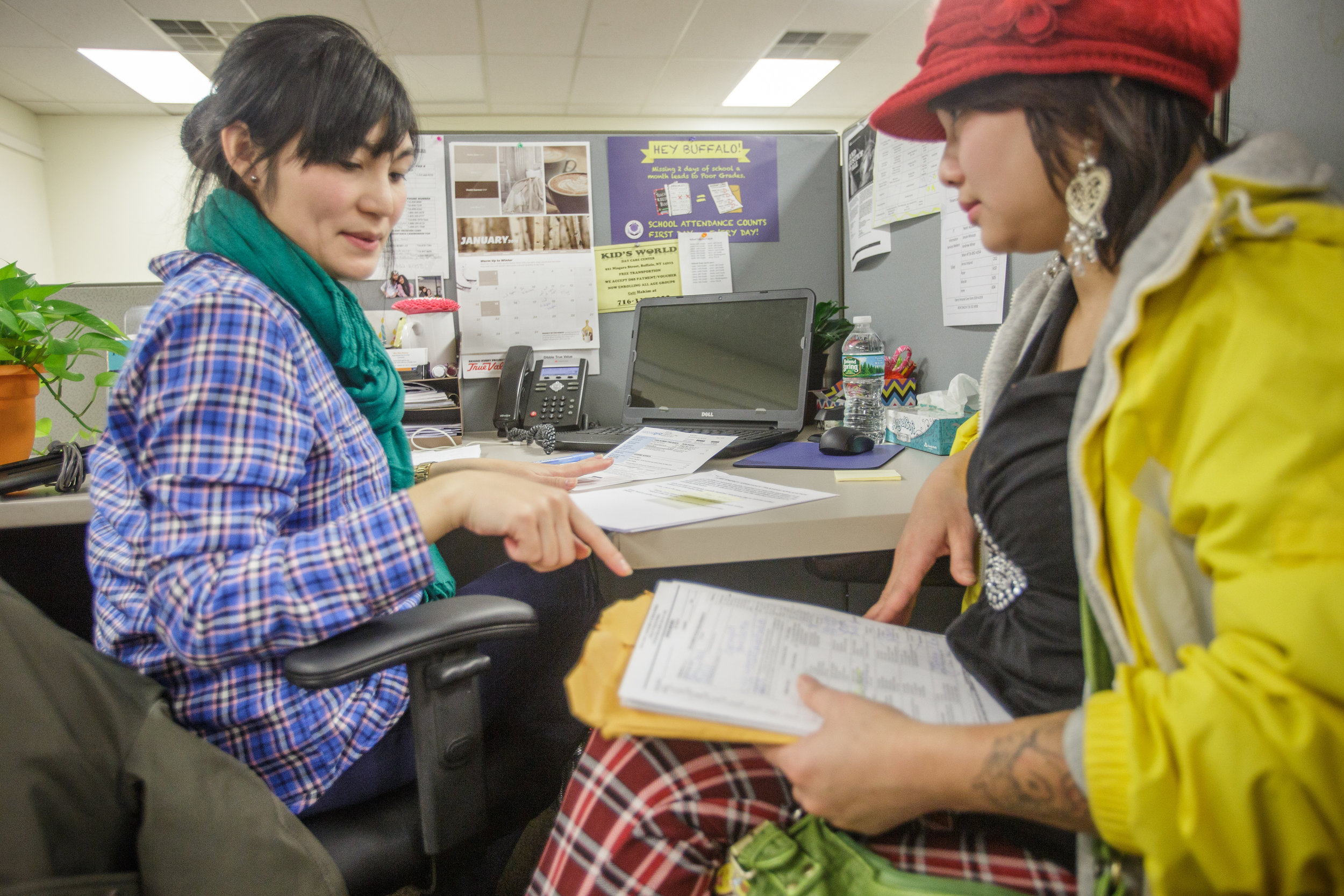Hope Refugee Drop-In Center case manager and client.jpg