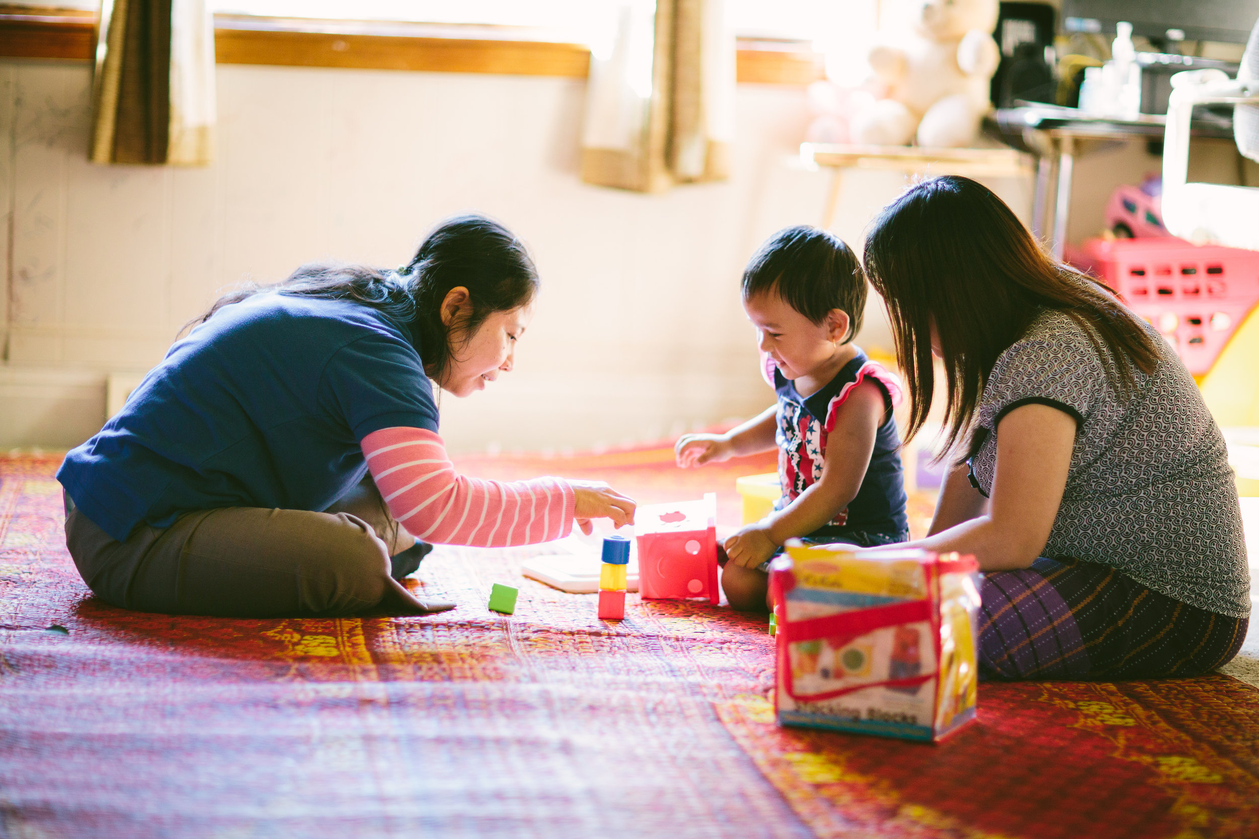 Parent-Child Home Program - child, parent, Early Learning Specialist home visit.jpg