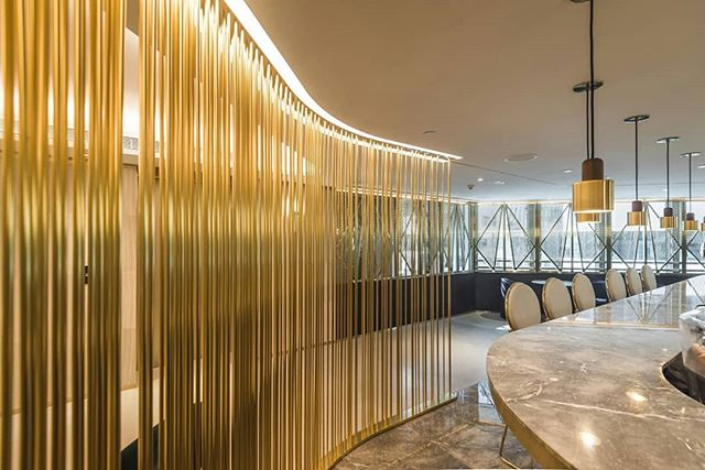 Delicate and exquisitely designed metal screens dividing dining space in The Refinery in Hong Kong. JEB Custom Projects team fabricated the screens from PVDF-coated aluminium rods with integrated LEDs.  #jebcustomprojects #metalscreens #customdesign #customprojects #interiorfeature #installation #hospitalitydesign