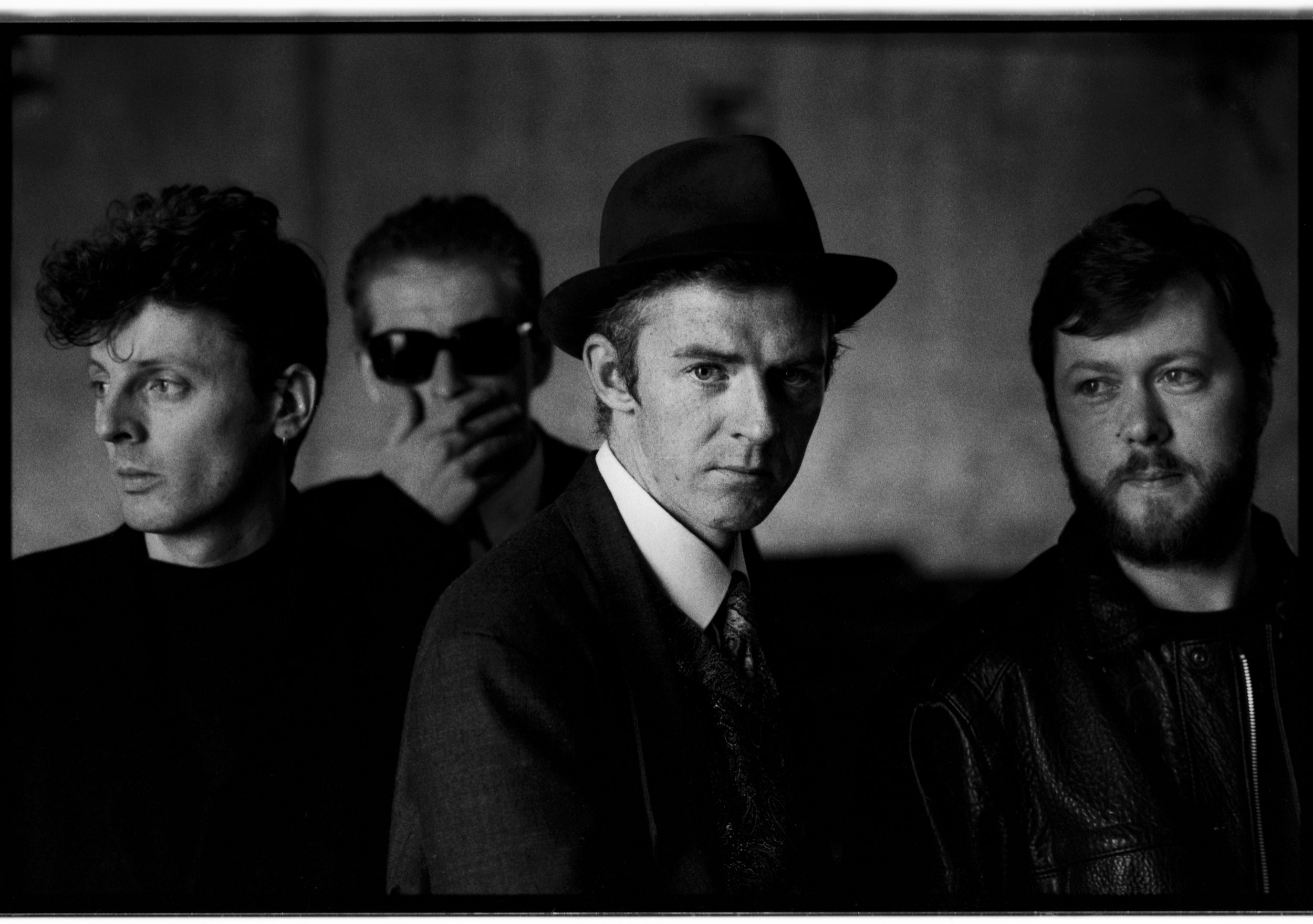 The Radiators photographed in the Dublin docklands in 1989. L-R Pete Holidai, Mark Megaray, Philip Chevron and Jimmy Crashe.