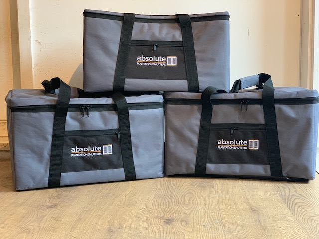 Grey padded bags with logo