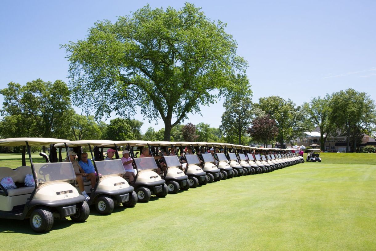 Golf carts wait on the green at the Play for the Cure Golf Outing on June 27, 2016. (Photo courtesy of Sheri Whitko Photography)