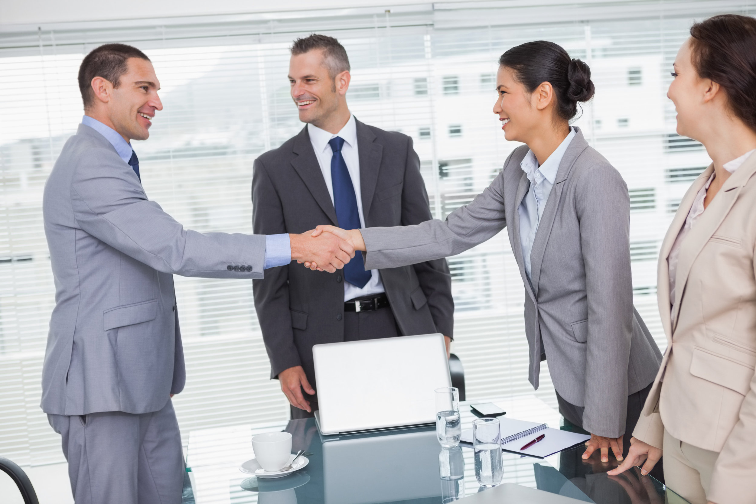 photodune-8459493-cheerful-business-people-meeting-and-shaking-hands-in-bright-office-l.jpg