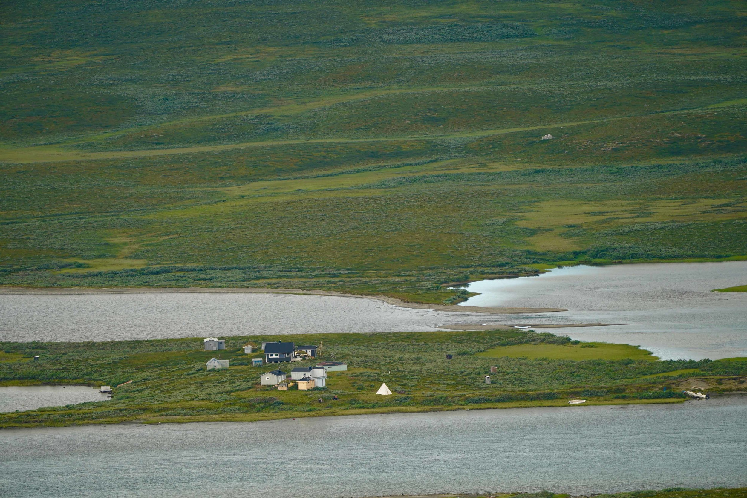 A remote Sámi village.The Sámi people are a Finno-Ugric people inhabiting Sápmi, which today encompasses large northern parts of Norway and Sweden, northern parts of Finland, and the Murmansk Oblast of Russia. The Sámi have historically been known in English as Lapps.