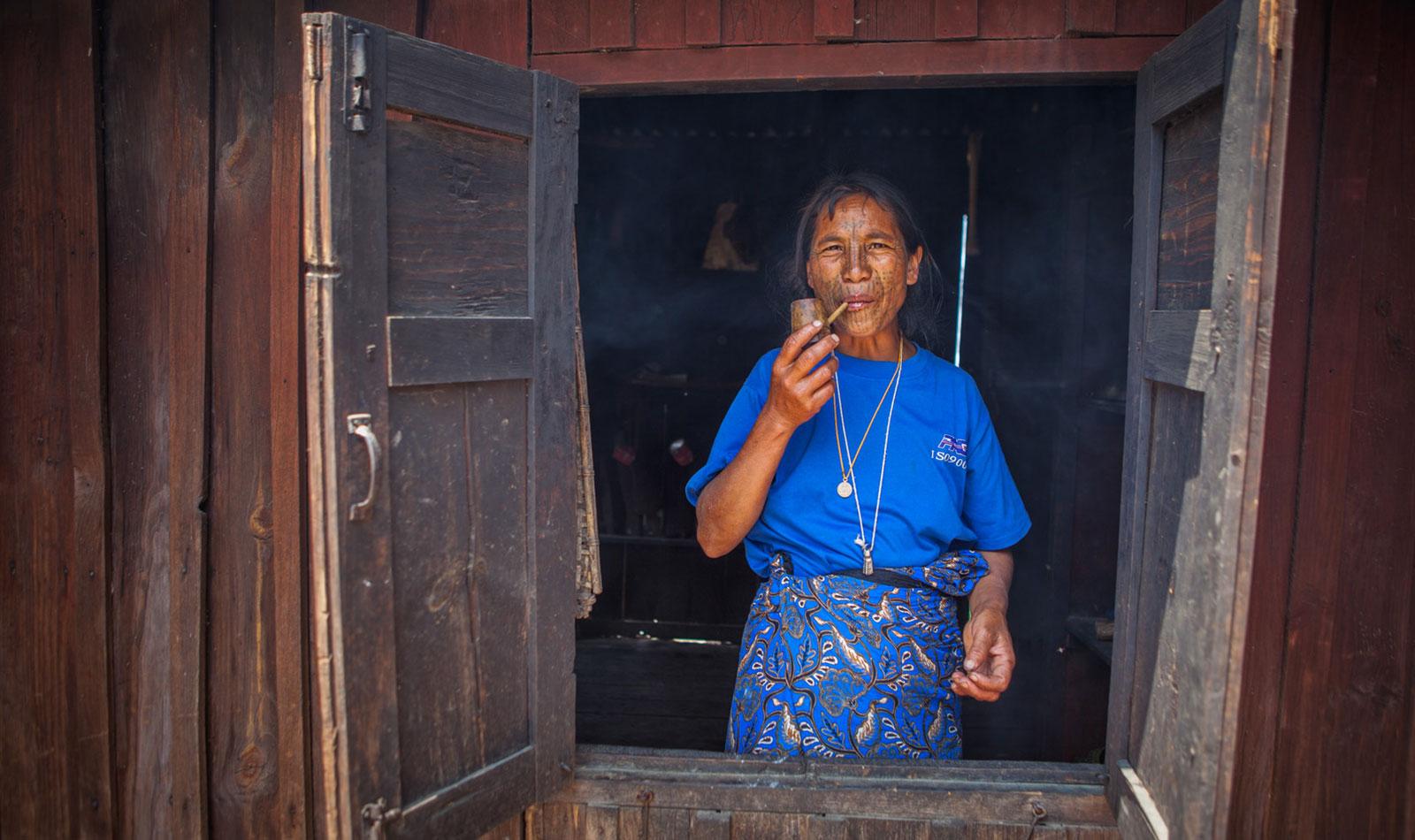 Myanmar-Chin-State-Tattooed-Faces-Woman-Smoking.jpg