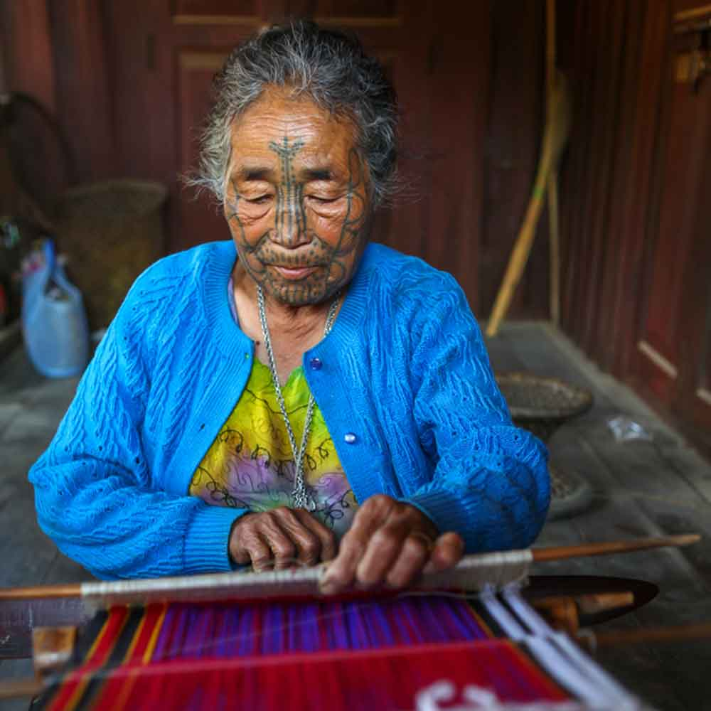 Myanmar-Chin-State-Tattooed-Faces-Woman-Weaving.jpg