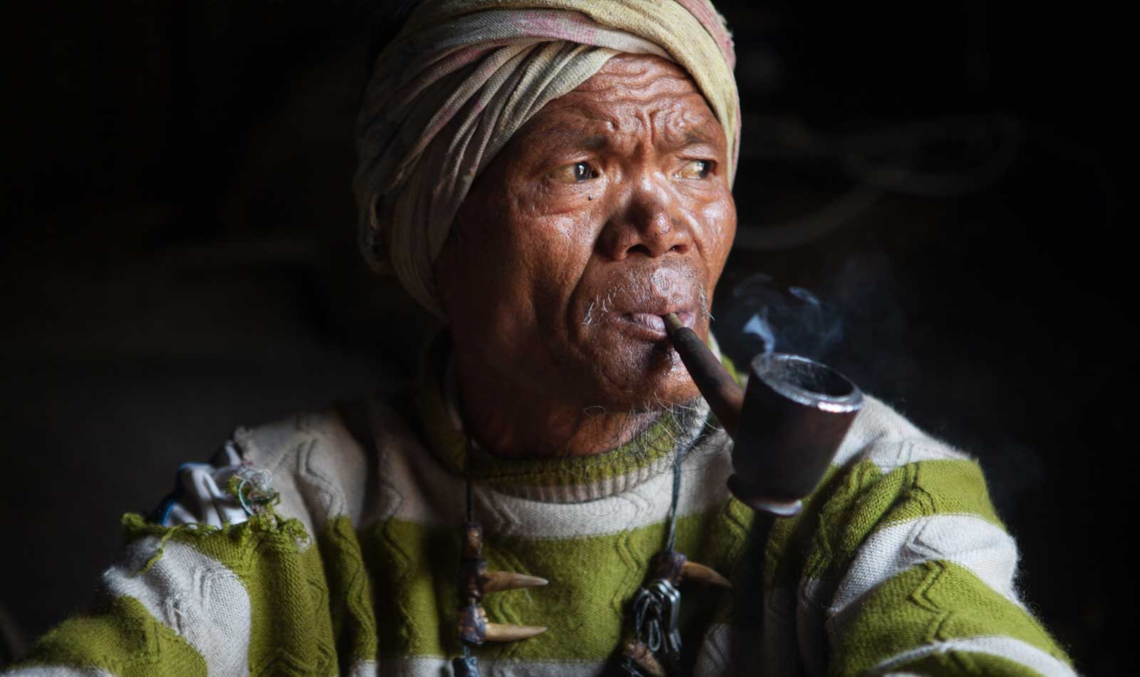 Myanmar-Chin-State-Tattooed-Faces-Man-Smoking.jpg