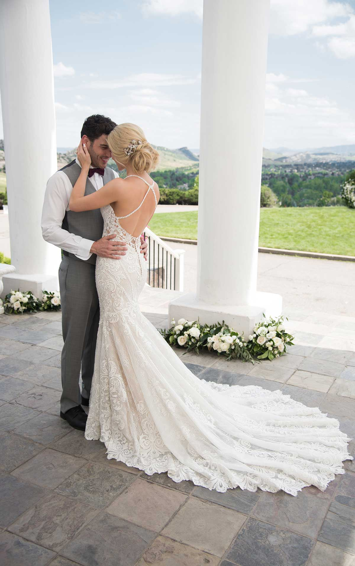 - This beautiful sheeth style lace wedding dress from Martina Liana features a stunning open back, dramatic train, and unique halter design. This gown is the perfect combination of sexy and sophisticated.