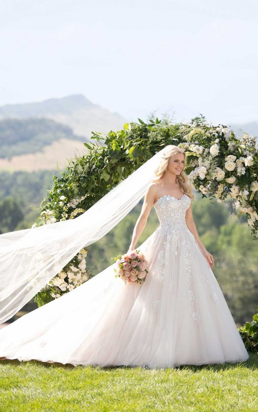 """- When we think """"Fairytale Wedding Dress"""" this gown is the first to come to mind. The sweetheart neckline and whimsical 3-D flowers and lace add to the elegance of this princess ballgown."""