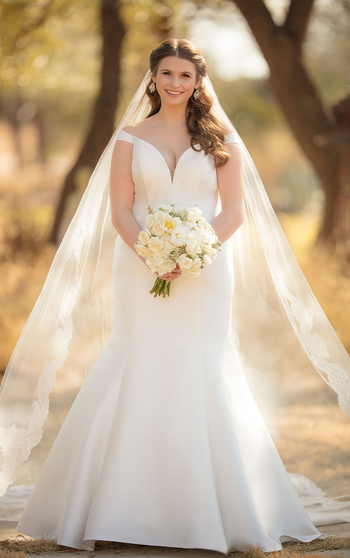 - The simplicity of this off-the-shoulder wedding dress from Essense of Australia is what makes it so glamorous and gorgeous. The old Hollywood Style of this mikado gown is perfect for the classic bride.