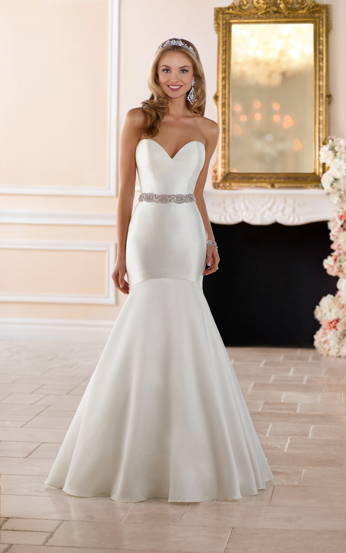 - This dropped waist fit-and-flare wedding dress is modern and elegant. The clean lines and mikado fabric make this simple wedding dress with a sweetheart neckline figure flattering.