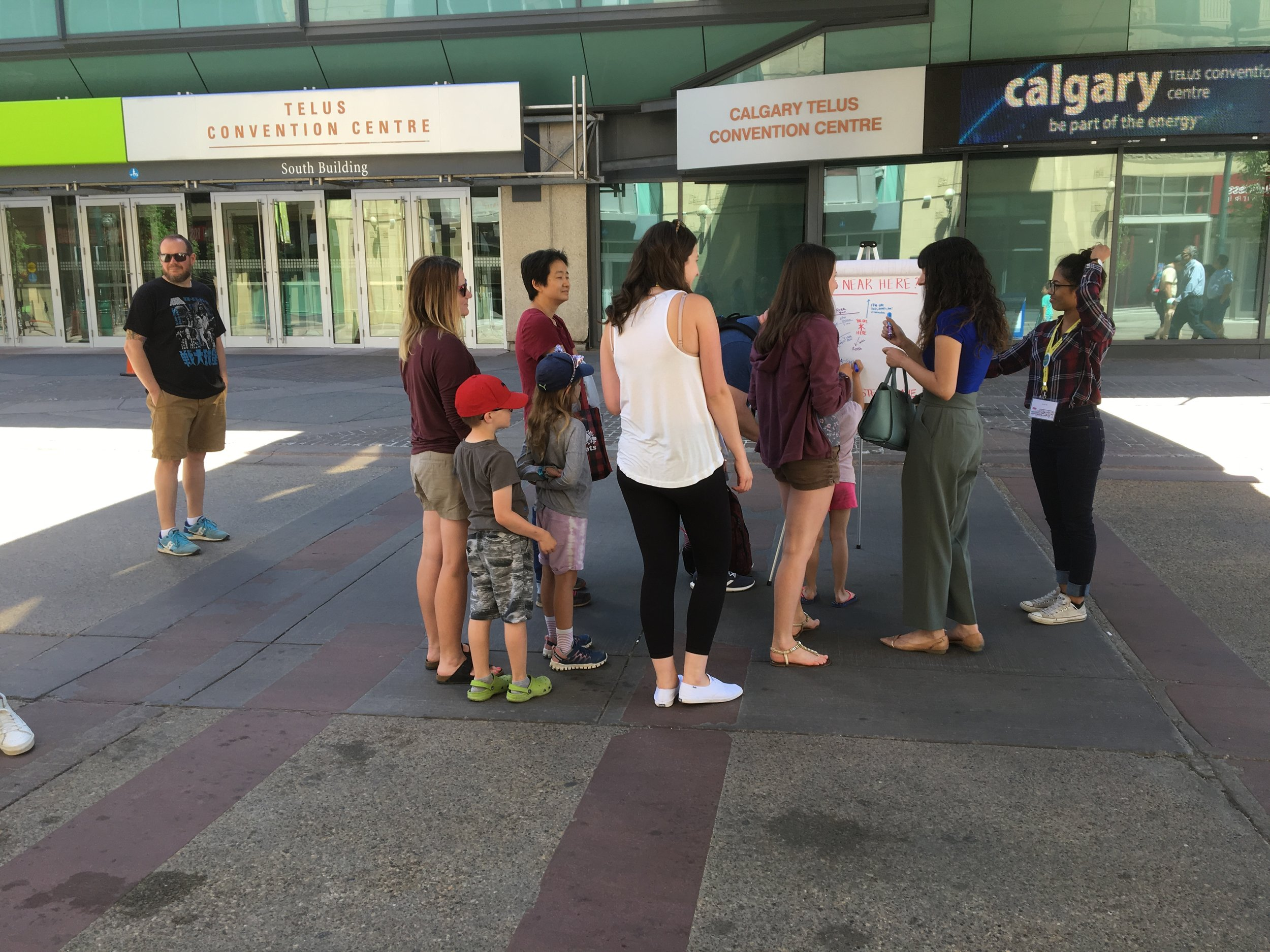 We observed and engaged with people interacting with the board on Stephen Avenue, with a low-fidelity version of a Near Here board.