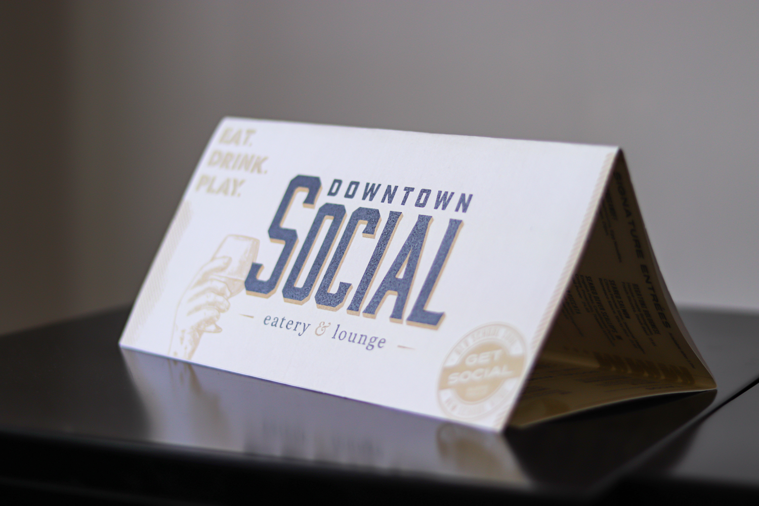Let's Get Social - The design was intended to be as much a marketing piece as it was a functional menu. The horizontal, trifold layout allowed for a built-in table tent at every place setting.