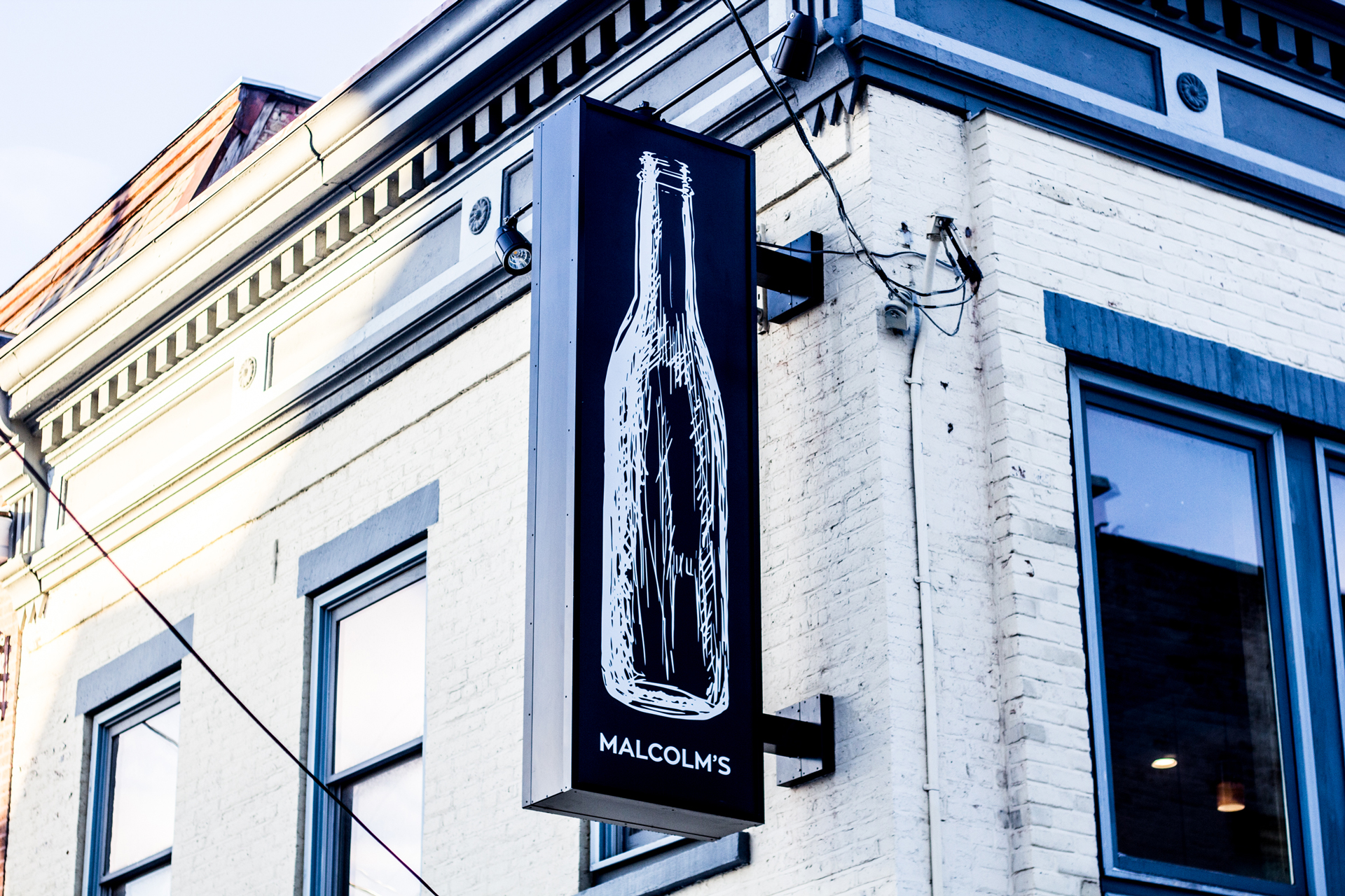 Larger Than Life - It's impossible to miss the signature bottle of Malcolm's when strolling down State Street in downtown Schenectady.