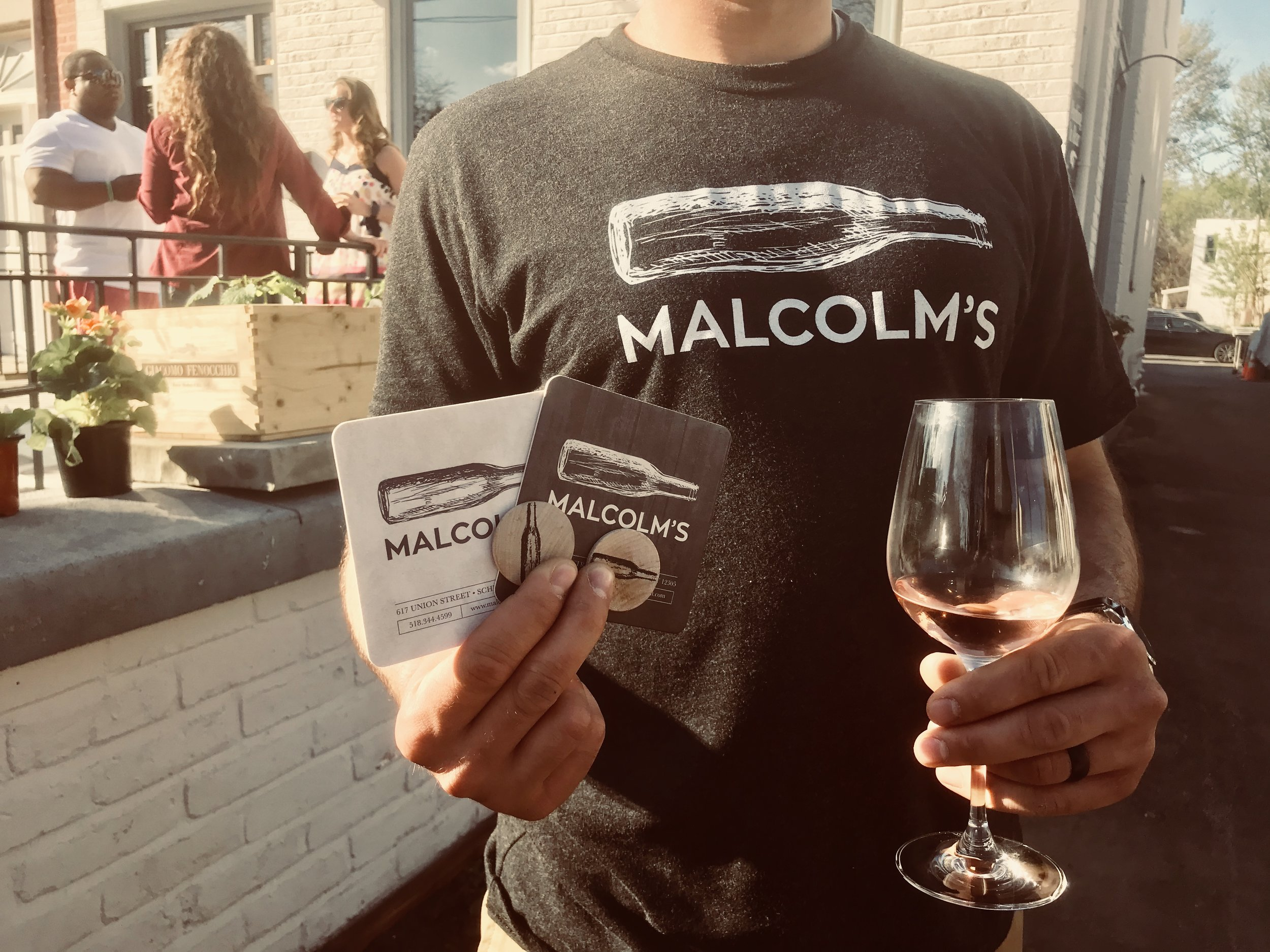 Bottoms Up - From t-shirts to aprons, coasters and gift cards, Malcolm's takes great pride in keeping every detail branded. Fun fact: the double-sided coasters, with one side light and one dark, are a sign to the waitstaff if patrons are drinking still or sparkling water for seamless service and attention to detail.