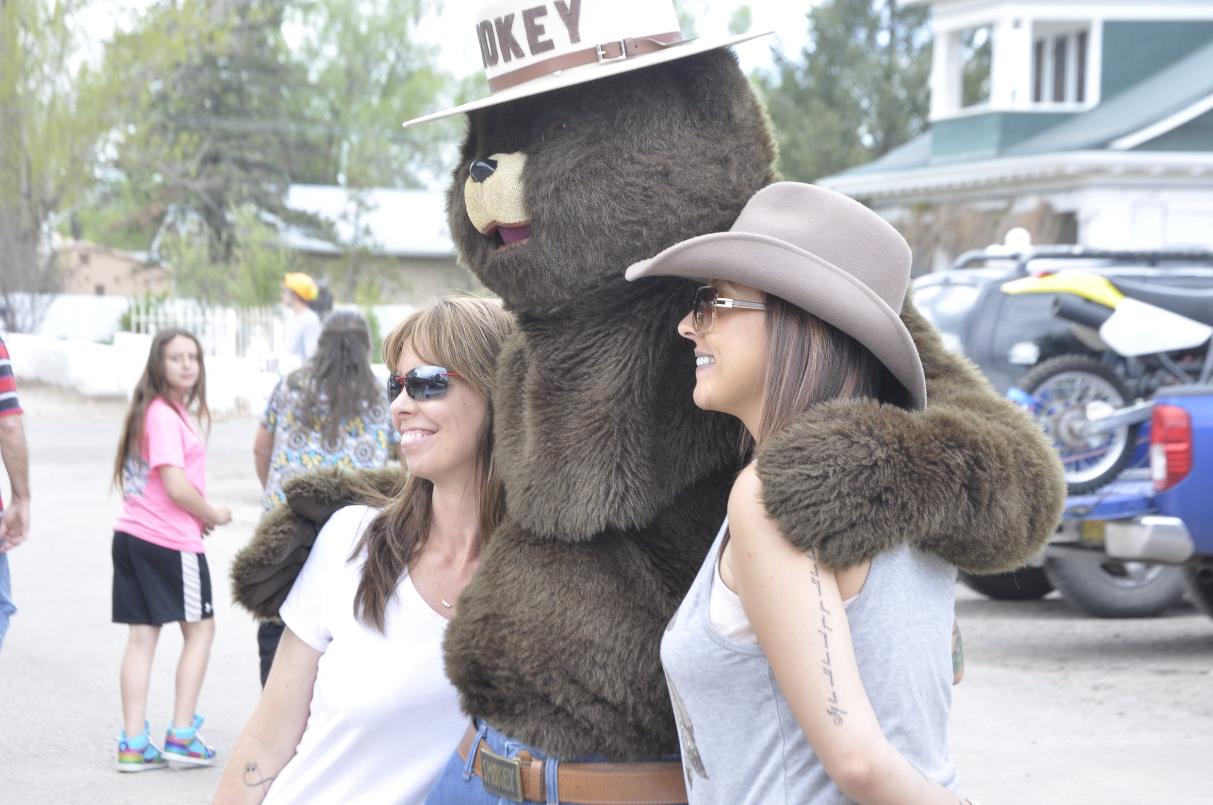 Smokey Bear with parade goers