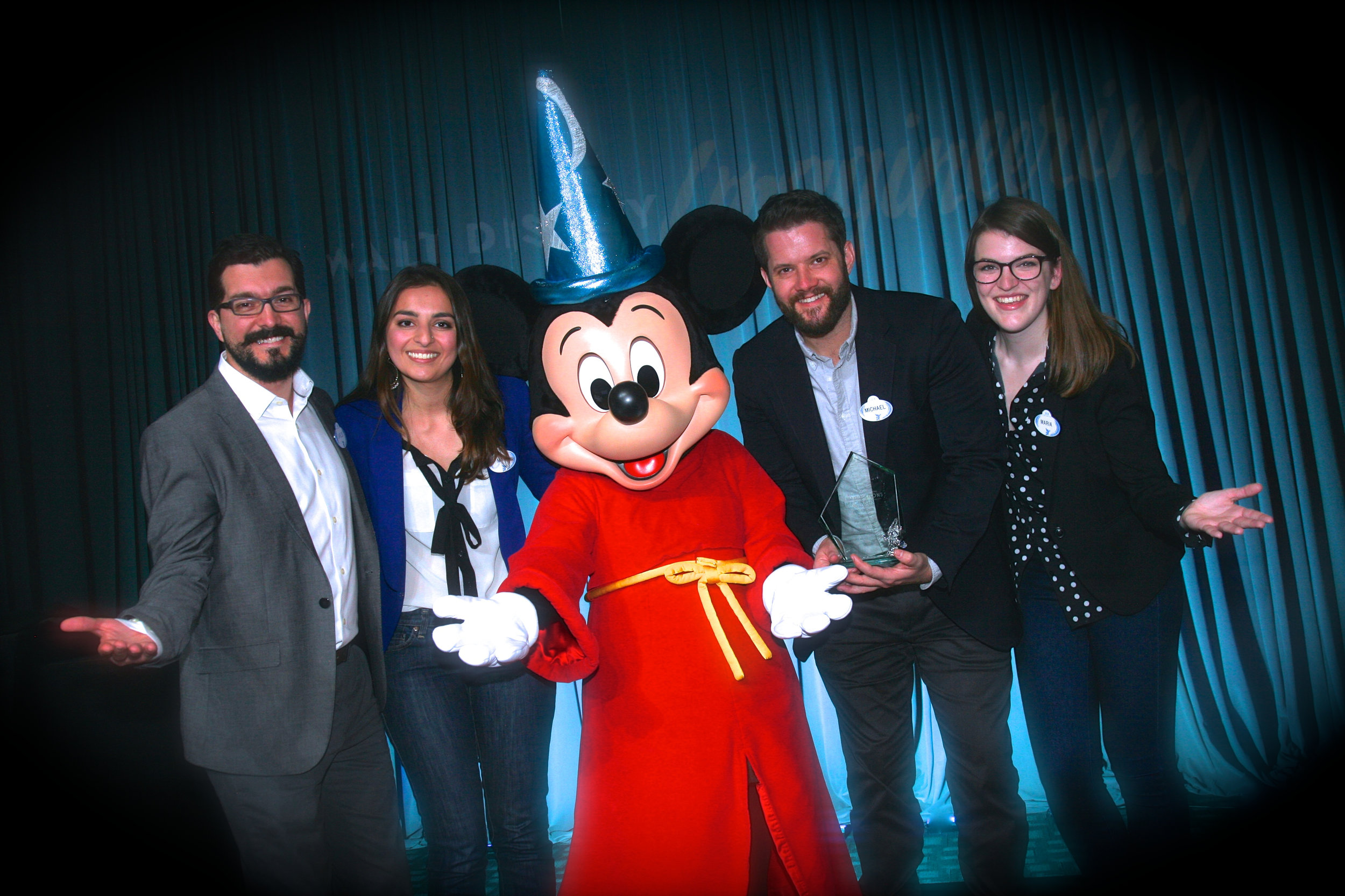 Team Caguaya takes first place at the 2018 Imaginations Competition! From Left: Carlos Ginatta, Maya Vyas, Mickey Mouse, Michael Howell, Maria Mondloch. Image courtesy of The Walt Disney Company.