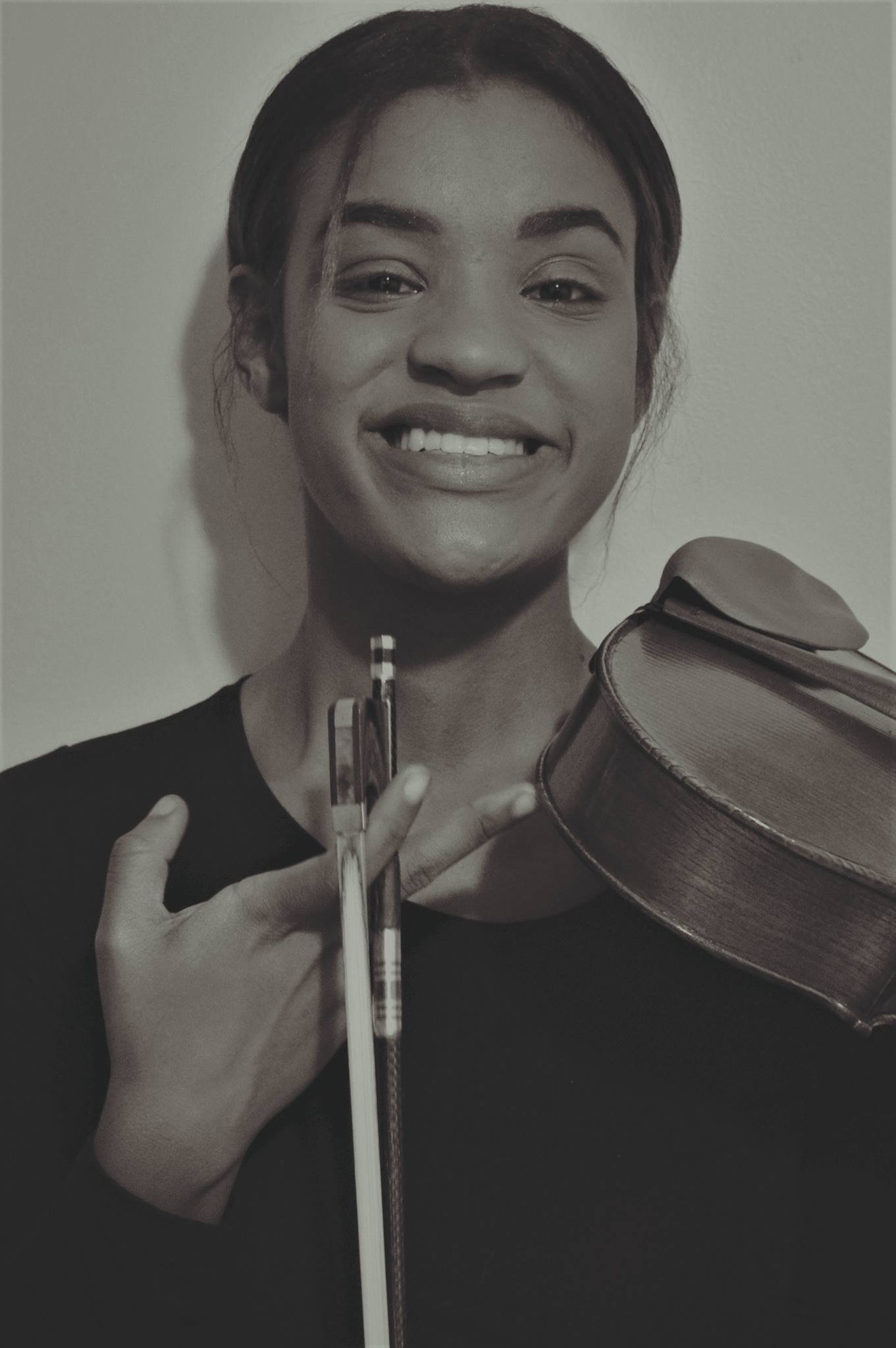 Megan Delatour (Violin, Viola, Cello)