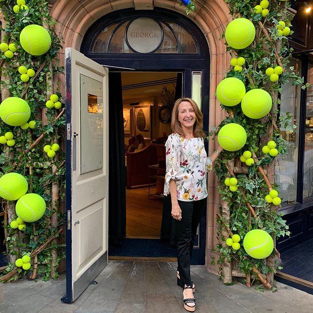 A great match! Restaurant decor in the spirit of Wimbledon...#doorwaysoftheworld  #tennisballs #matchpoint #timingiseverything #championship #lemonadetolace