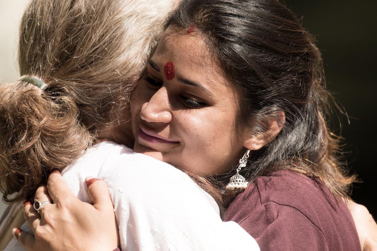 evolve-and-radiate-aditi-grandy-life-guidance-hugging-woman.JPG