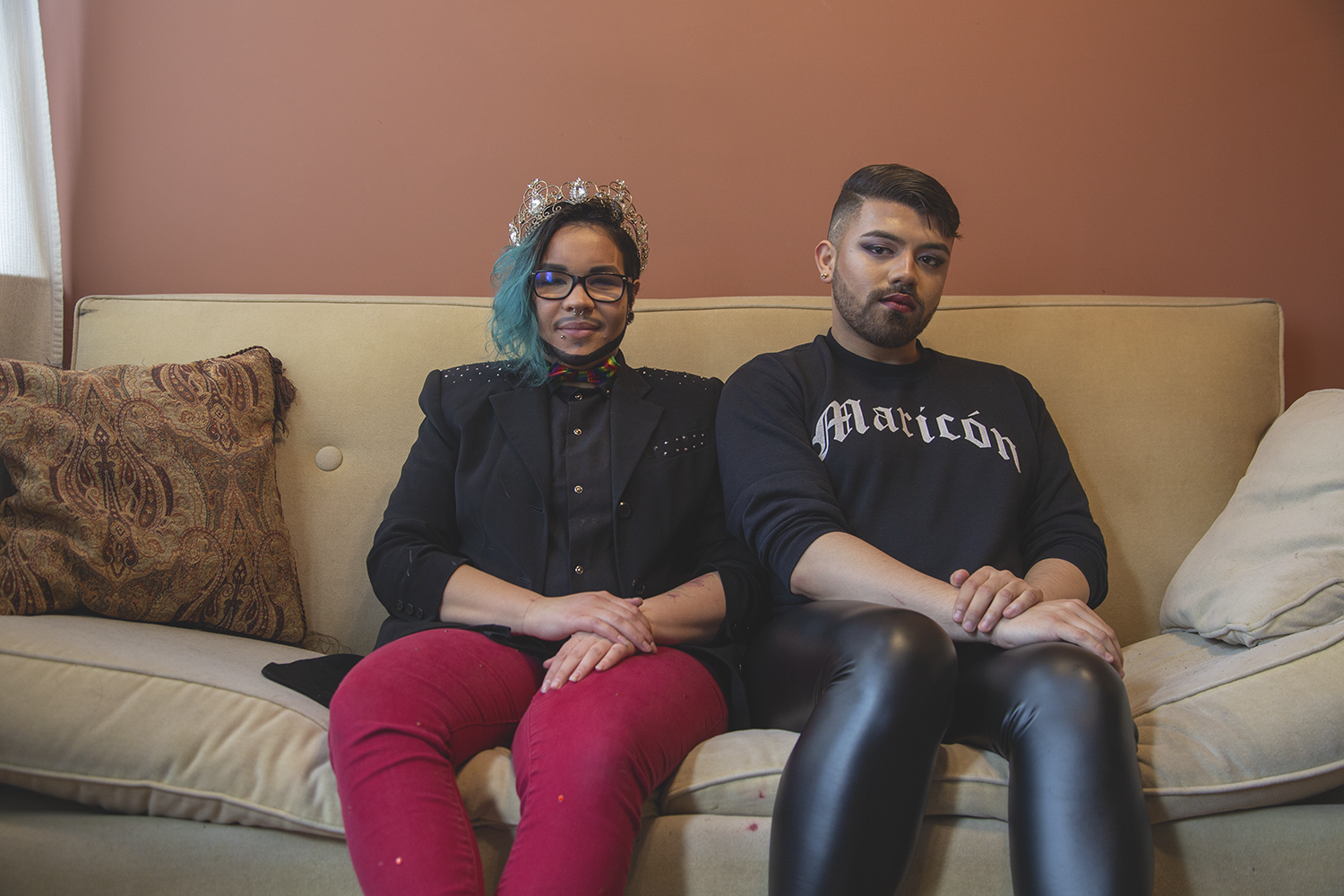 Yadiel Melendéz sits on a next to their friend, Pablo Ventura in their home on February 8th, 2019.  Segunda Familia  is a 3-portrait project that demonstrates Queer people with their chosen family. As queer people, our families aren't always supportive of us, so we search for family figures in our communities.