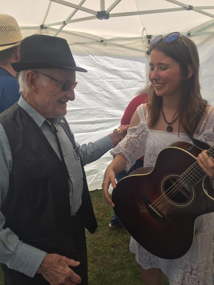 The legendary Jesse McReynolds caught my show at the John Hartford Memorial Festival in Indiana. And he liked it. Jesse is the current oldest living member of the Grand Ole Opry and an innovative guitar and mandolin player. In Jan 2017 he was on the tv series Nashville as a blind singer who inspires Rayna James. He is also a fiddle so we had a lot in common. He's telling me how much he enjoyed my show in Bean Blossom.
