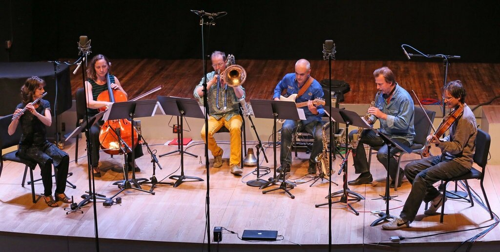 Dedalus Ensemble  From left, Amélie Berson, on flute; Deborah Walker, on cello; Thierry Madiot, on trombone; Didier Aschour, on guitar; Pierre Stéphane Meugé, on saxophone; and Cyprien Busolini, on viola, performing at their first United States concert, at Roulette on Monday.CreditCreditRuby Washington/The New York Times