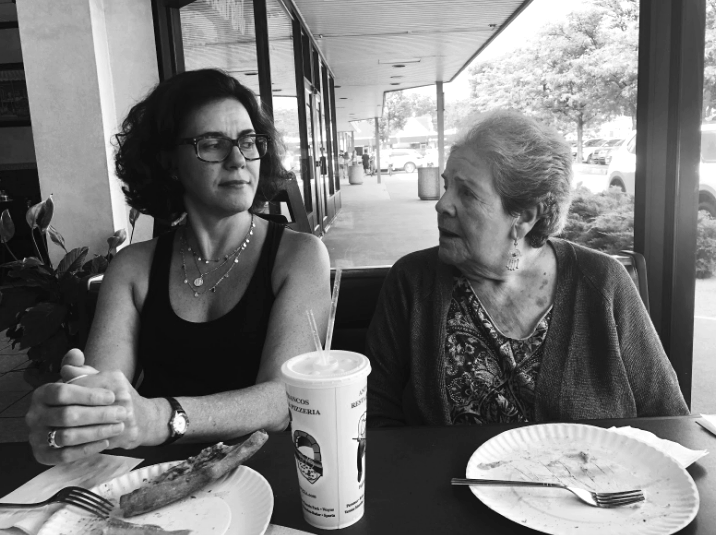 My mother and grandmother looking at each other.