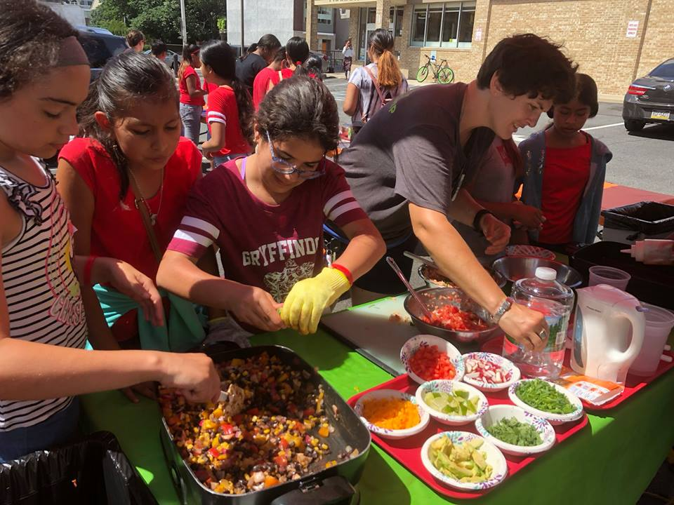 In 2018, Vetri Community Partners taught local students how to prepare healthy foods via their Mobile Teaching Kitchen, courtesy of a Bloktoberfest grant.