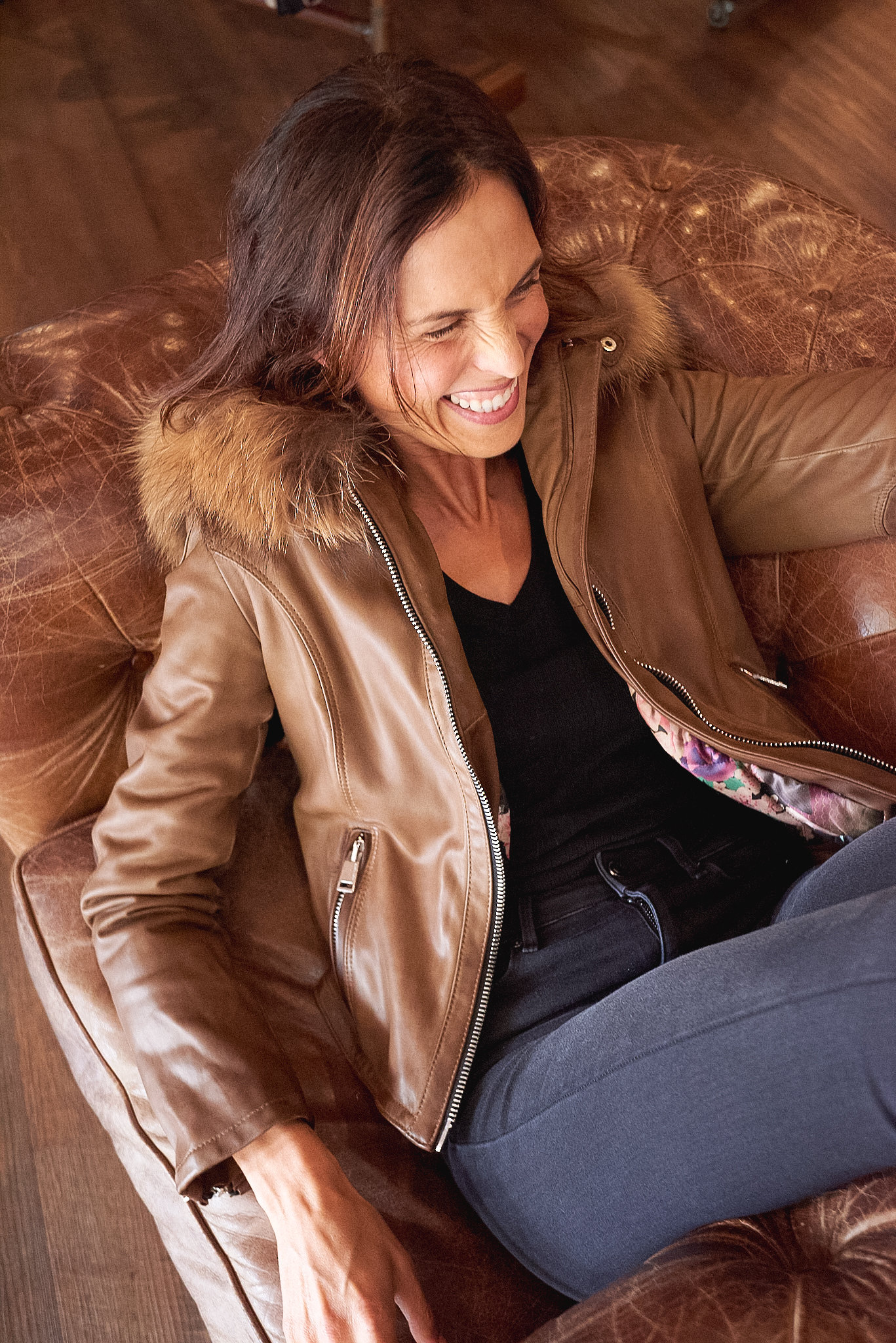 Abigail wears Delan Leather Jacket with hood, (Oil colour) $1560 and Reiko Demin, Black Jeans $219