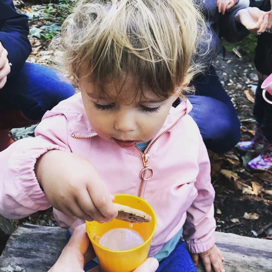 Learning to dunk her biscuit in hot chocolate - an essential life skill don't you think!