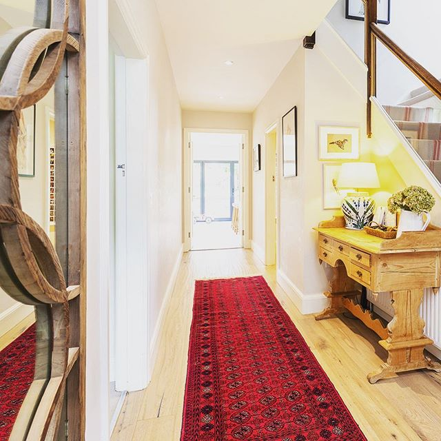 Simple hallways with a runner that could tell a few stories.. #persianrugs #rogeroates