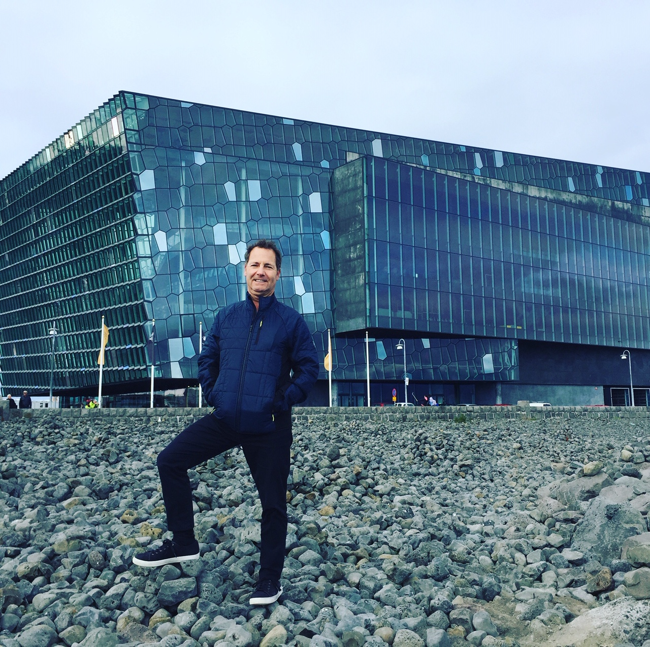 Rich Granoff in front of Harpa, a concert hall and conference center located in Reykjavik. Completed in 2011, the centralized layout with perimeter circulation allows natural daylight to flood the interior.  Image courtesy of Rich Granoff