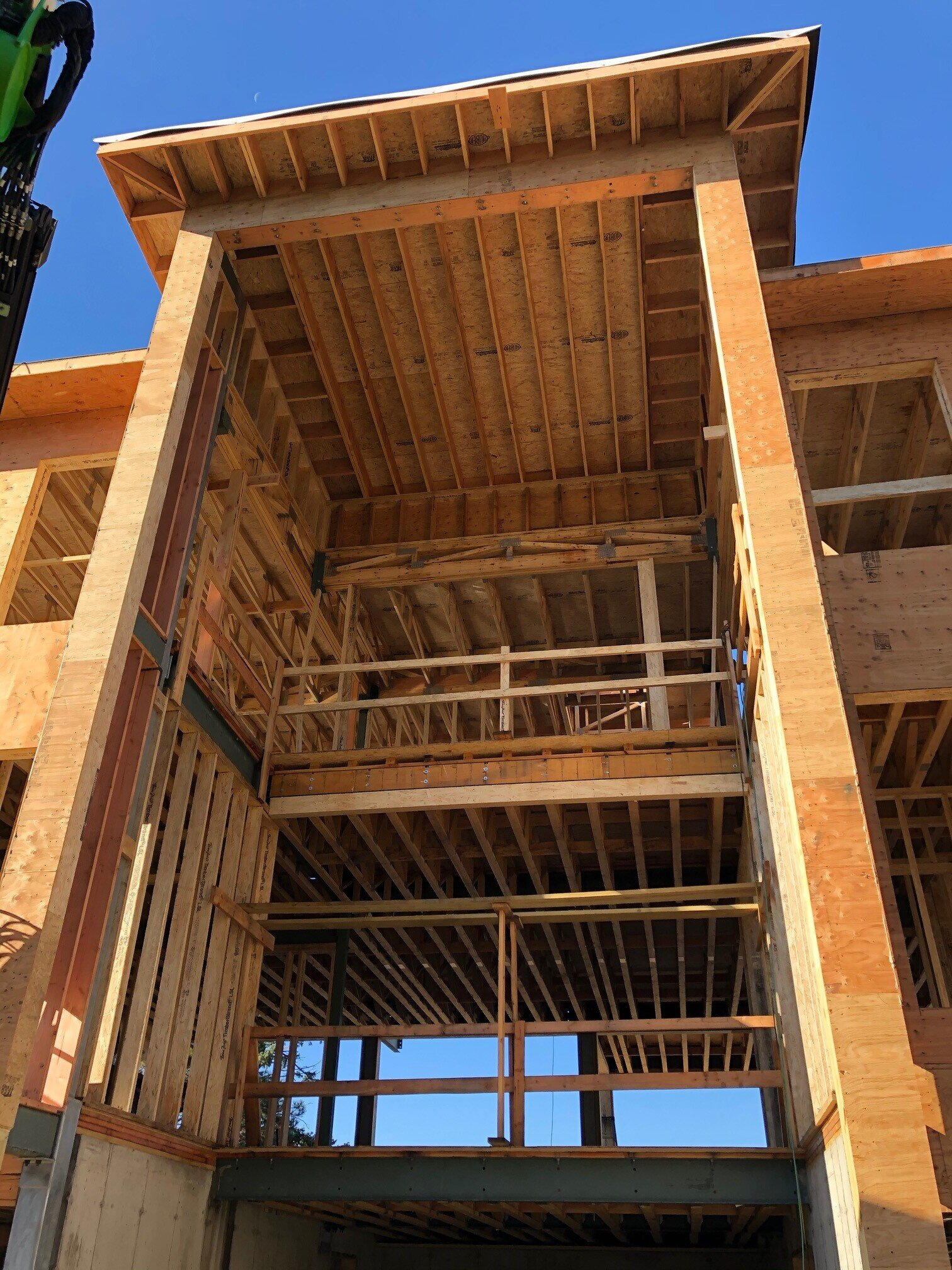 Wood framing elements installed at Osprey Point; all voids will be expanses of glass, including the face of this staircase/elevator shaft.  Image via Granoff Architects.